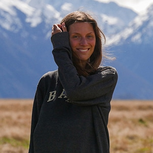 Kathrin founder of give & grow portrait in New Zealand infant of mountains