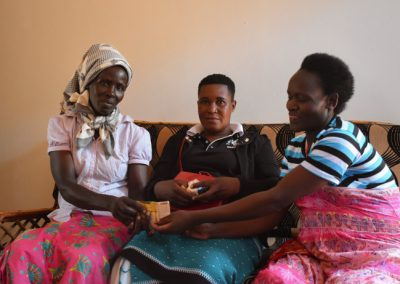 Project picture giving a loan to business women Uganda