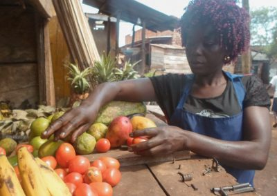 Project picture women Sustain ME Uganda woman working on her fruit stand