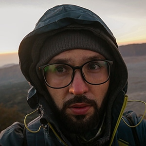 Wojtek part of the team profile picture with this glasses and jacket on sunrise